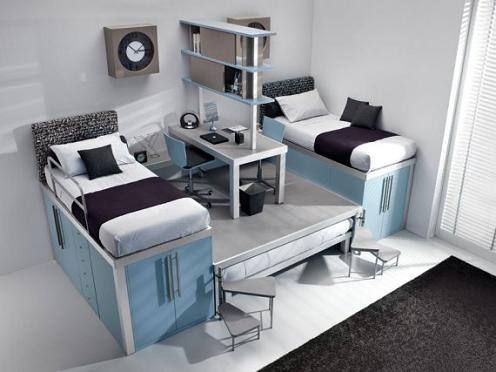 una cama mueble y centro de juegos desplegable