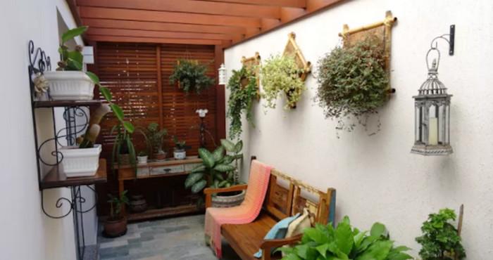 12 estilos para albergar plantas en jardines peque os for Lindos jardines pequenos